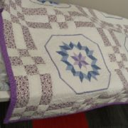 quilt using embroidery, 9 patch and rail fence blocks